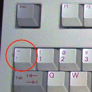 Где находиться кнопка тильда