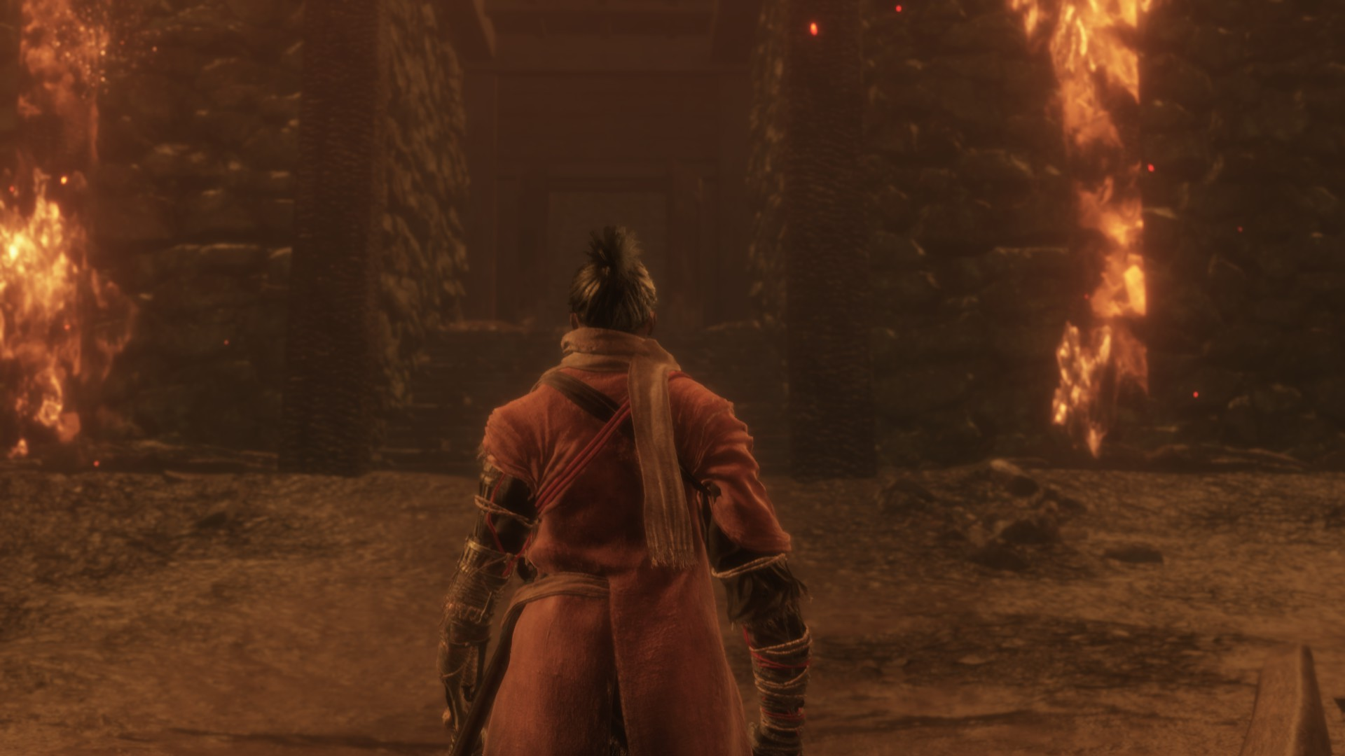 Sekiro's protagonist aka the wolf is standing alone in a hall that is caving in and burning right now.